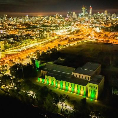 Power Station And Cbd At Night Green And Gold Lighting